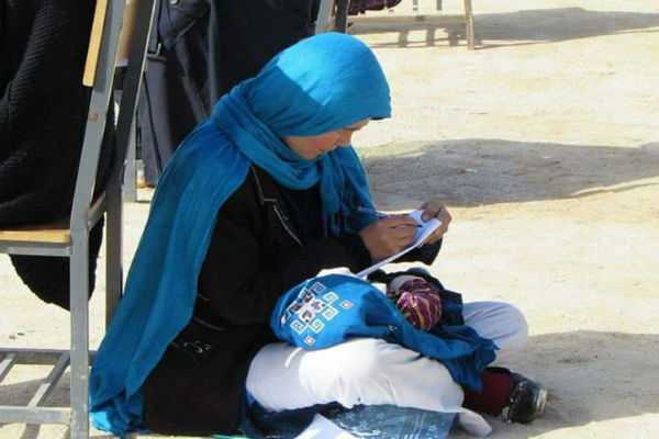 picture-of-afghan-woman-nursing-baby-while-taking-exam-goes-viral