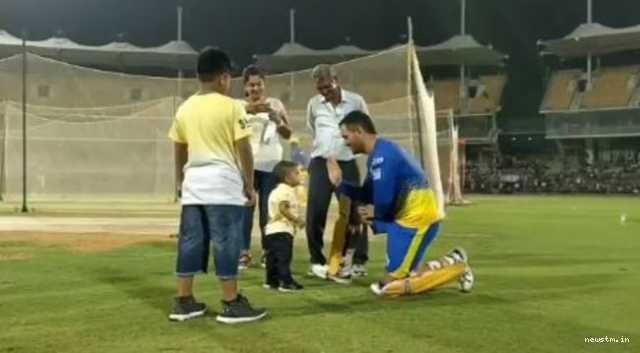 dhoni-s-cutest-hi-fi-with-baby