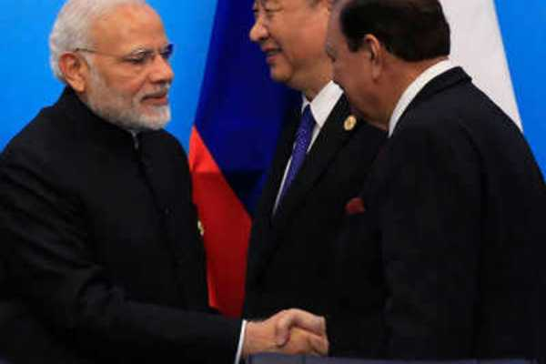 mamnoon-modi-shake-hands-in-china