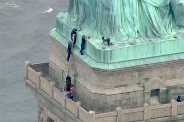 statue-of-liberty-climber-in-custody-after-forcing-evacuation