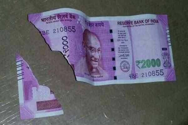 rbi-announces-new-rules-for-exchange-of-damaged-rs-2000-200-notes