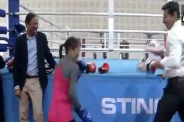 sports-minister-rajyavardhan-singh-rathore-in-a-friendly-boxing-bout-with-boxing-champion-mary-kom-at-indira-gandhi-stadium-in-delhi