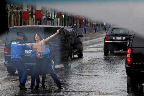 topless-female-protester-runs-at-trump-s-motorcade-in-paris
