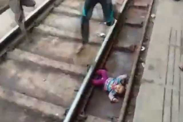 one-year-old-emerges-unhurt-after-train-passes-over-her-in-mathura-railway-station