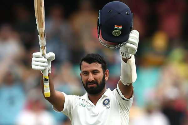pujara-reached-his-hundred-with-a-boundary