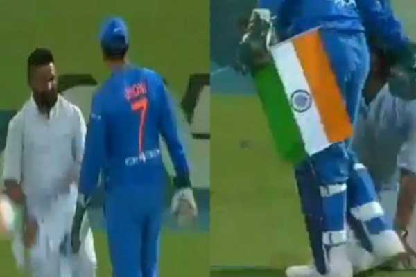 dhoni-saved-the-national-flag-which-was-dropped-by-his-fan