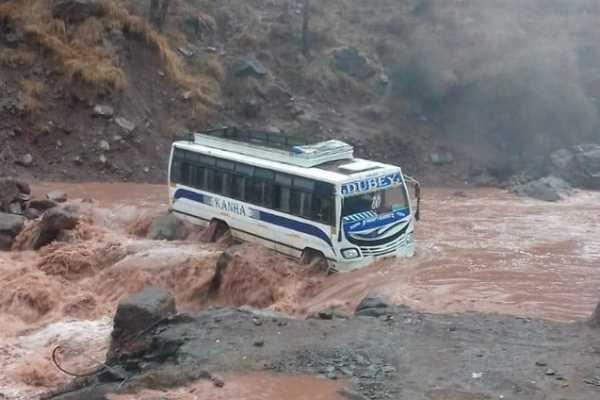 jammu-kashmir-following-incessant-rain-in-panchari-a-bus-on-its-way-from-katti-to-udhampur-is-stuck-in-latyar-nallah