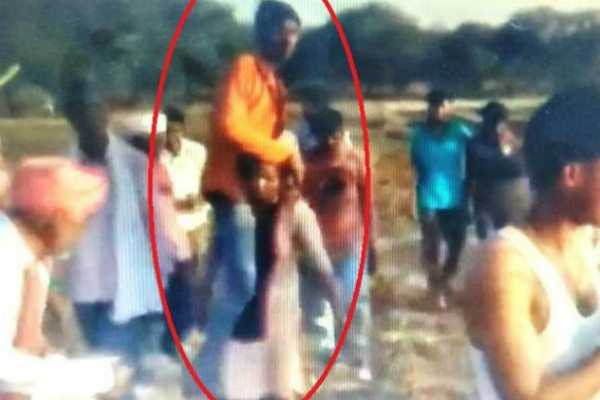 madhya-pradesh-woman-shamed-forced-to-walk-with-husband-on-shoulders