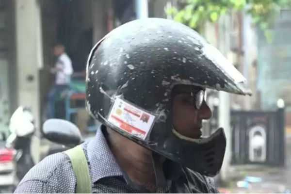 traveling-biker-with-bike-documents-on-helmet