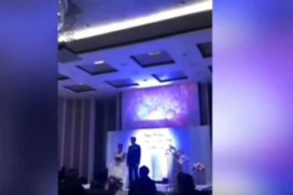 groom-plays-video-of-cheating-bride-in-bed-with-another-man-at-their-wedding